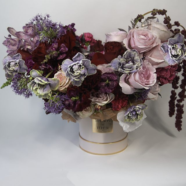 Passionate tango - Pink round box with European style arrangement consisting of Dutch tulips, roses, and field flowers - passionate and romantic