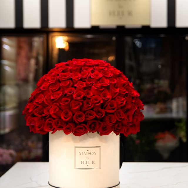 Hugs of love - Classic white box with premium red roses