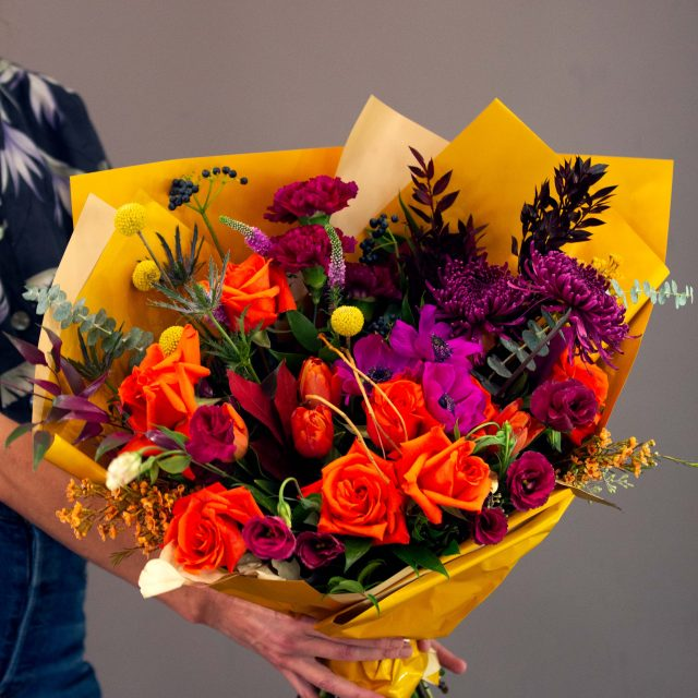 Cuba Libre - Vibrant European style bouquet  mixed with fascia and hot coral roses